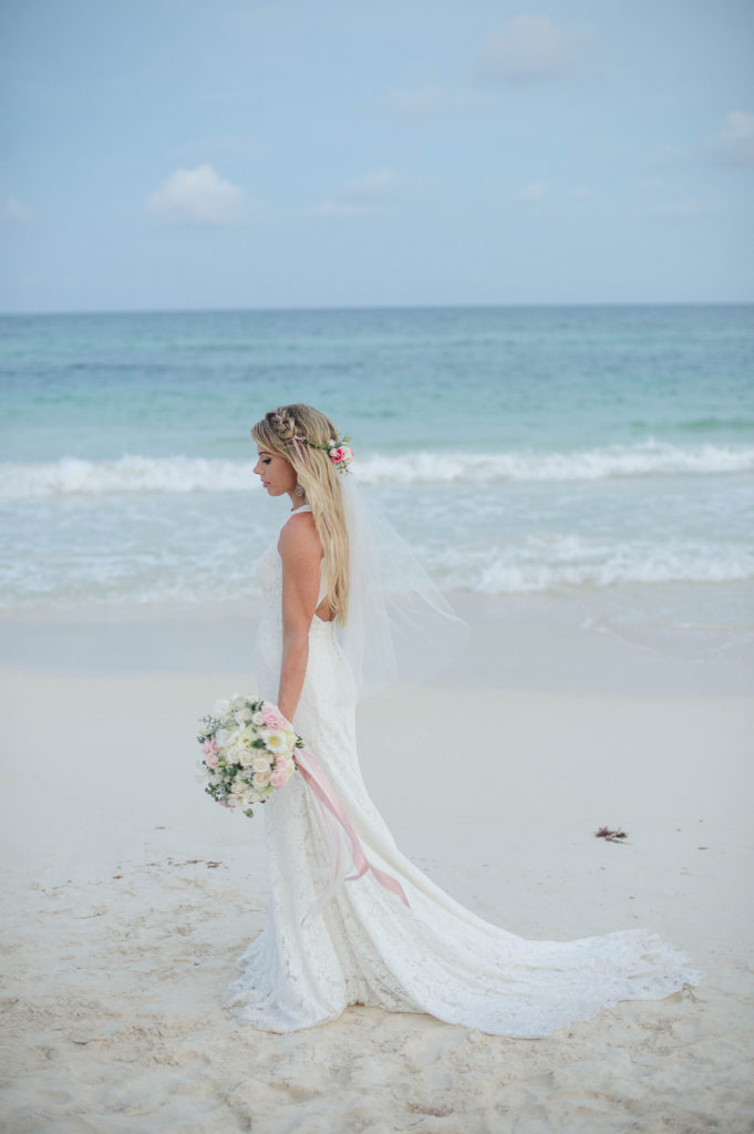 pink bouquet and bride on the beach