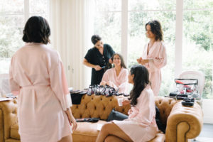 bridesmaids getting ready hair and makeup